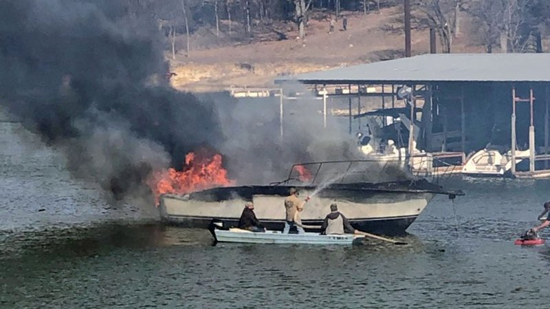 Firefighters extinguish a burning boat at Grandpappy Point Marina on January 8, 2020. (KTEN)